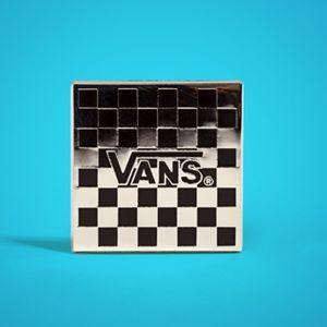 Vans checkerboard collectible pin.